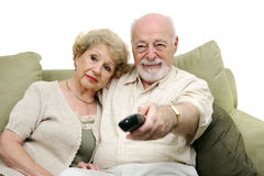Seniors Channel Surfing Stock Image
