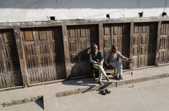 Seniors citizens enjoying the sun. Nepali citizens enjoying the sun in Kathmandu Royalty Free Stock Images