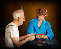 Seniors citizens playing cards. Older couple playing card game Stock Image