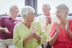 Seniors clapping hands Royalty Free Stock Photo