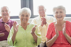 Seniors clapping hands Royalty Free Stock Image