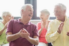 Seniors clapping hands Stock Images