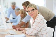 Seniors in computing class Stock Photo