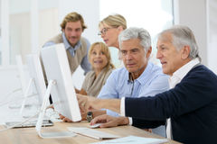 Seniors at computing class Royalty Free Stock Images