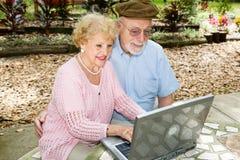 Seniors Computing Outdoors Royalty Free Stock Photo