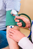 Seniors controlling blood pressure at home Royalty Free Stock Photography