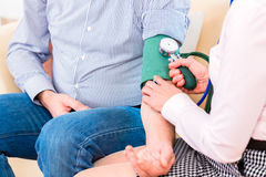 Seniors controlling blood pressure at home Stock Photography