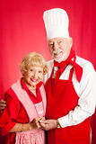 Seniors Cook Together royalty free stock photos