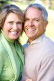 Seniors couple. Happy elderly seniors couple in park stock photos