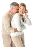 Seniors couple. Happy elderly seniors couple in love. Isolated over white background Royalty Free Stock Image