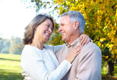 Seniors couple. Happy elderly seniors couple in park royalty free stock images