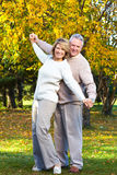 Seniors couple. Happy  elderly seniors couple in the forest Royalty Free Stock Photography