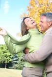 Seniors couple. Happy elderly seniors couple in park Royalty Free Stock Image