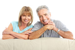 Seniors couple. Happy seniors couple in love. Healthy teeth. Isolated over white background Royalty Free Stock Image