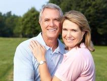 Seniors couple. Happy elderly seniors couple in park royalty free stock photography
