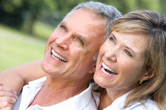 Seniors couple. Happy elderly seniors couple in park Stock Image