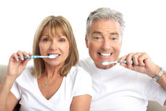 Seniors couple. Happy seniors couple with toothbrushes. Healthy teeth. Isolated over white background stock photos