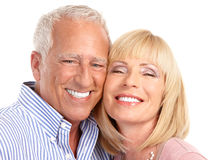 Seniors couple. Happy seniors couple in love. Healthy teeth. Isolated over white background Royalty Free Stock Photos
