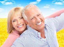 Seniors couple. Happy smiling elderly seniors couple under blue sky Stock Images