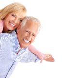 Seniors couple. Happy seniors couple in love. Healthy teeth. Isolated over white background stock photos