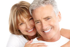 Seniors couple. Happy seniors couple in love. Healthy teeth. Isolated over white background