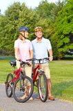 Seniors couple biking Royalty Free Stock Photos