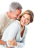 Seniors couple. Happy seniors couple in love. Healthy teeth. Isolated over white background Royalty Free Stock Images