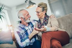 Seniors couple at home measuring blood pressure. Home monitoring Stock Images