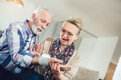 Seniors couple at home measuring blood pressure. Home monitoring Royalty Free Stock Photos