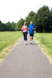 Seniors couple jogging stock photos