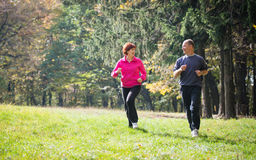 Seniors couple jogging Stock Photo