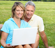 Seniors couple with laptop Royalty Free Stock Photo