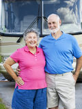 Seniors Couple with RV. Portrait of healthy retired couple in front of their motor home Royalty Free Stock Photos