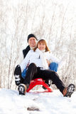 Seniors couple on sled Royalty Free Stock Photo