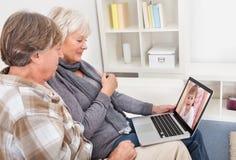 Seniors couple using with laptop Royalty Free Stock Image