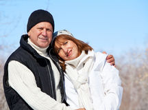 Seniors couple in winter park Stock Images