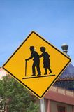 Seniors crossing. A senior crossing warning sign in Calgary's china town royalty free stock photos