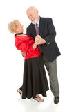 Seniors Dancing - The Dip. Romantic senior couple dancing together.  He's dipping his beautiful wife.  Full body isolated Stock Photos
