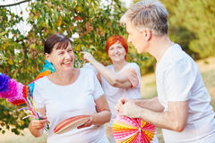 Seniors decorating for a summer birthday party Royalty Free Stock Photo