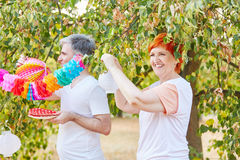 Seniors decorating for a summer party Royalty Free Stock Photo