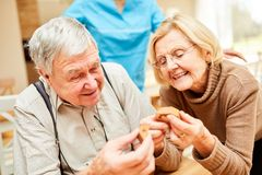 Seniors with dementia play a puzzle. Seniors with dementia play a wood puzzle as employment or therapy stock images
