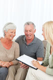 Seniors with doctor at home Stock Photography