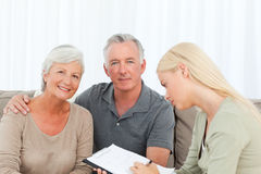 Seniors with doctor at home Royalty Free Stock Photography