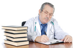 Seniors doctor writing Royalty Free Stock Image