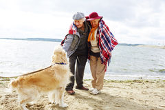 Seniors with dog Royalty Free Stock Photos