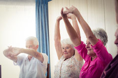 Seniors doing exercises Stock Photo