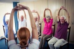 Seniors doing exercises Royalty Free Stock Images