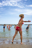Seniors doing fitness on Cattoica beach, Emilia Romagna, Italy Stock Photos