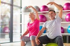 Seniors doing fitness exercises stock photo