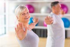 Seniors doing fitness exercises Stock Images